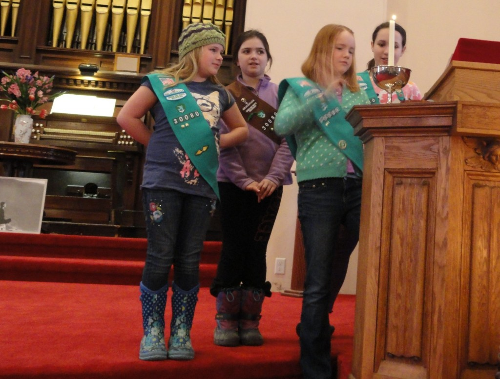 Girl Scouts lighting the chalice during Girl Scout Sunday.